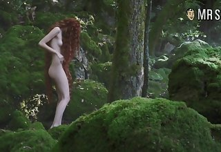 Red haired temptress Stacy Martin standing naked close to a forest