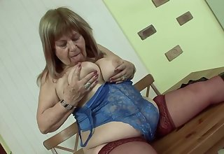 Elderly Hungarian woman with big, saggy tits is grousing while riding a press hard cock