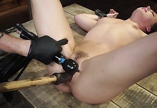 Massive inches of toy in her tiny holes for a real BDSM fetish
