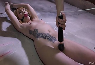 Elektra Angels is bound coupled with flogged before her cunt is overstimulated