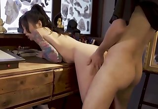 Asian Tattoo Artist, Ai Qiu Is Hale Fianc� One Of Her Clients In Her Studio
