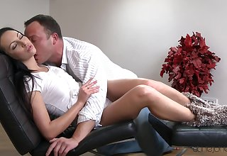 Murky with long hair, naked sex coupled with oral fun on a leather chair