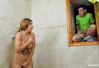 Teen lad fucks his stepmom after spying on her elbow the shower