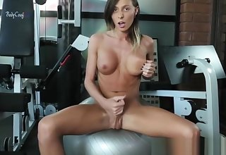 Big-busted transwoman tugs cock after working out