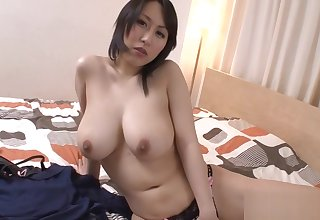 Massive tits Asian stimulates the brush cunt with lusty insertions