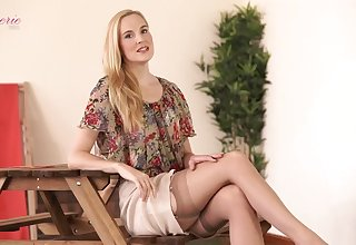 Leggy small tittied blonde Ariel Anderssen gets naked and tells erotic stories