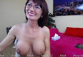 Brunette Mature nourisher in eyeglasses teasing solo on webcam