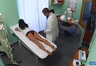 Amateur girl strips for her check-up but her new doctor gets turned on