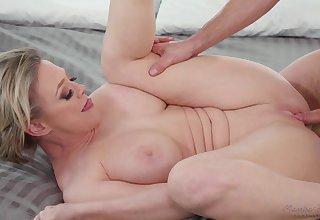 Busty mature blonde Dee Williams loves having sex with a younger person