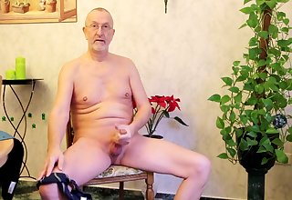Mature pervert is all naked and busy with wanking his own cock